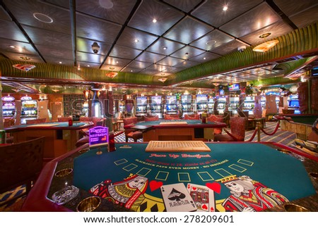 "CARNIVAL ""CONQUEST"" - 3:20 AM. JUNE 5, 2008: ""Face UP Black Jack"" table. Tahiti Casino. Located on Promenade deck, with 15 tables and 350 slot machines. Available for unforgetable fun at sea           - stock photo"