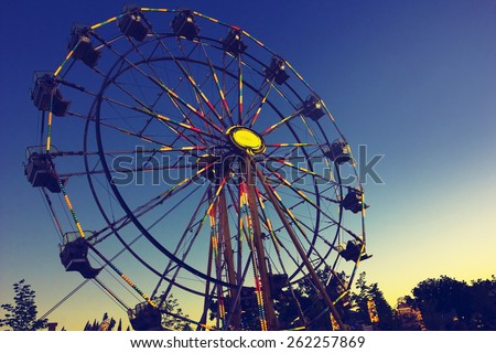Carnival Ferris Wheel at sunset - stock photo