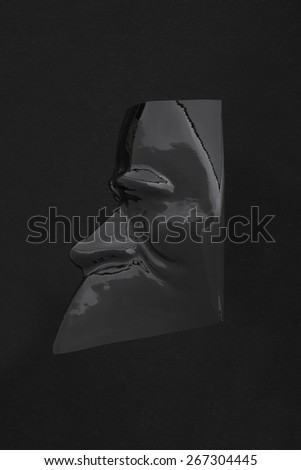 Carnival glossy black mask profile on black, clipping path included - stock photo