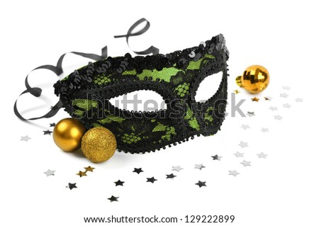 carnival green mask with silver confetti on white background - stock photo
