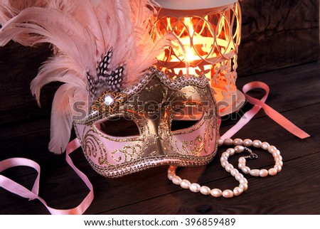 Carnival mask and candlestick - stock photo