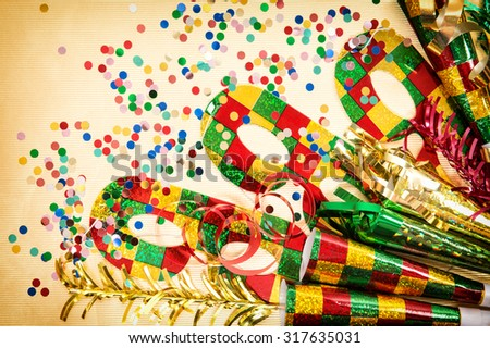 Carnival mask and decorations. Holidays background. Symbol of venetian mask festival - stock photo