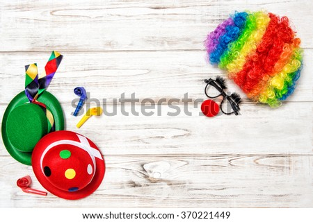 Carnival mask clown with wig. Holidays background - stock photo