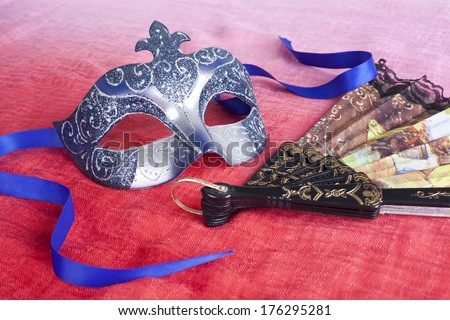 Carnival mask. Fan. - stock photo