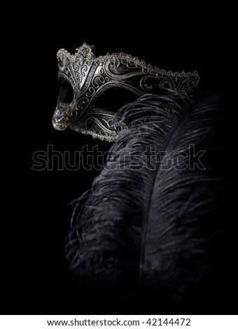 carnival mask isolated on black with feather - stock photo