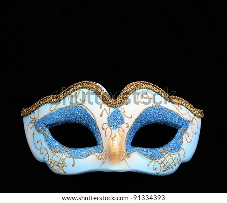 Carnival mask on a black background with room for your text - stock photo