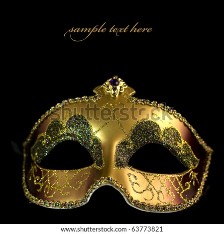 Carnival mask on a black background (with sample text) - stock photo