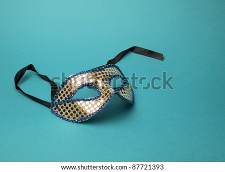 Carnival mask on a blue background - stock photo