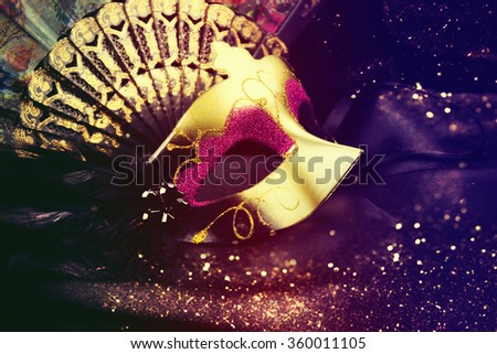 Carnival mask on a dark background. - stock photo