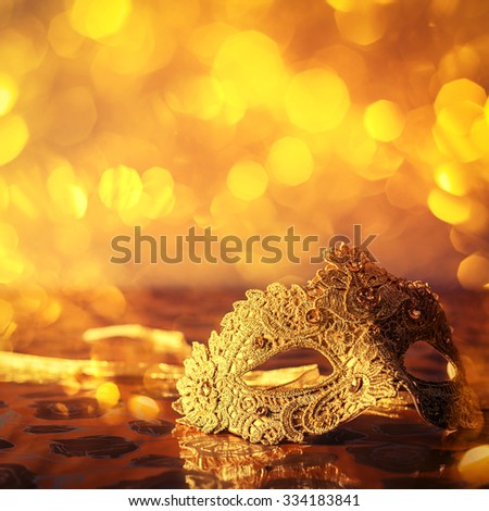 carnival mask on a golden background - stock photo