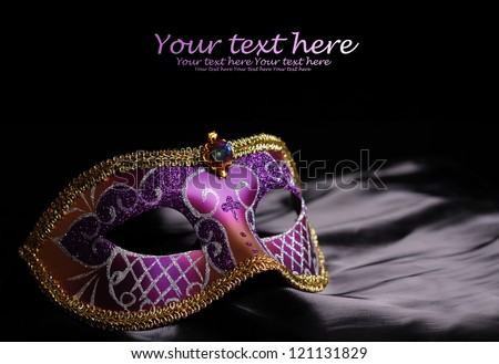 Carnival mask on black silk background - stock photo