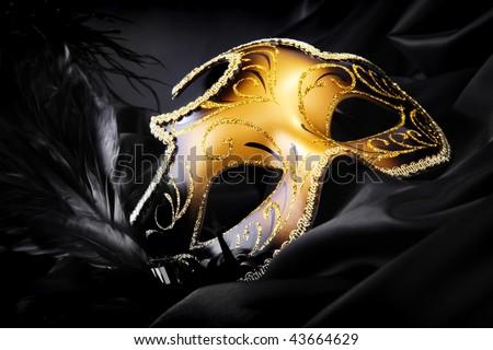 Carnival mask on black silk background - stock photo