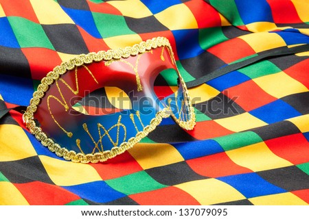 carnival mask on buffoon's disguise - stock photo