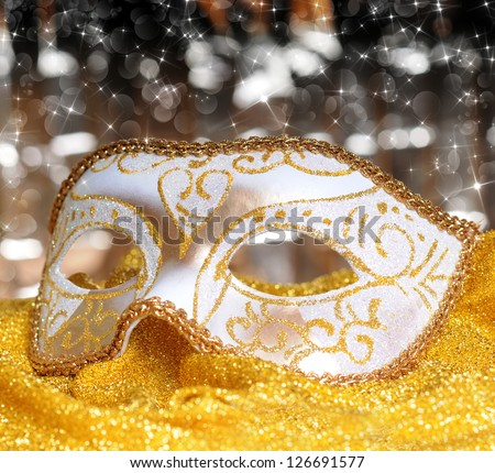 Carnival mask on golden material background