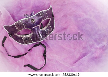 Carnival mask on purple and pink background - stock photo