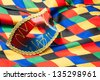 carnival mask on rhombs cloth - stock photo