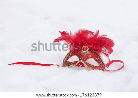 Carnival mask on the snow