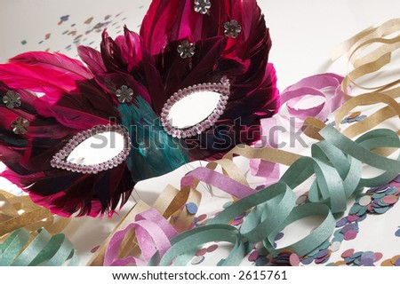 Carnival Mask with some confetti - stock photo