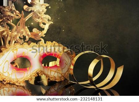 Carnival mask with Vintage candelabrum   - stock photo