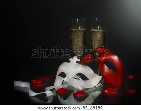 Carnival masks and christmas champagne on the black background - stock photo
