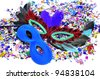 carnival masks and confetti of different colors - stock photo