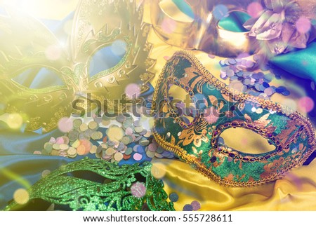 Carnival masks on colorful background