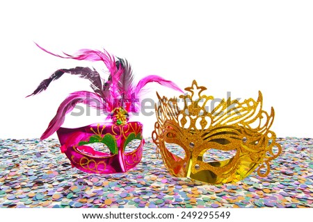 Carnival masks on confetti and white background  - stock photo