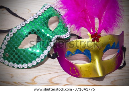 carnival masks on wood - stock photo
