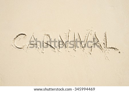 Carnival message handwritten in smooth sand on Ipanema Beach in Rio de Janeiro, Brazil