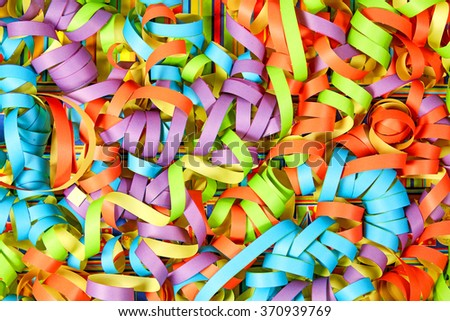 Carnival paper ribbons background with different colors - stock photo