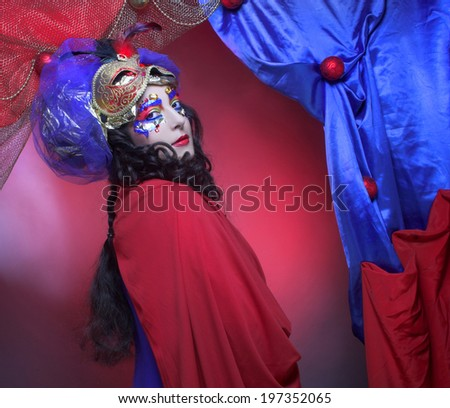 Carnival. Portrait of charming brunette in bright artistic image.