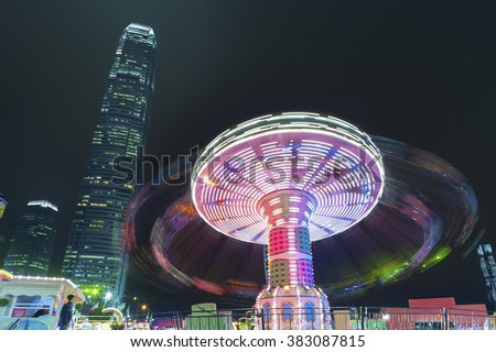 Carnival ride in action at night - stock photo