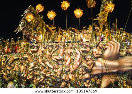 CARNIVAL RIO DE JANEIRO - FEBRUARY 19: Beija-Flor samba school parade float  at the Sambadome February 19, 2012 in Rio de Janeiro, Brazil. The Rio Carnival is the biggest carnival in the world. - stock photo