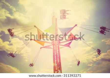 Carnival swing ride. Instagram filter,  - stock photo