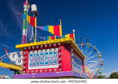 Carnival Ticket Booth and Rides.