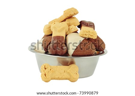 Carob and plain gourmet dog biscuits isolated on a white background with clipping path included. - stock photo