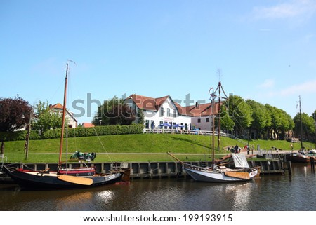 CAROLINENSIEL, GERMANY - JUNE 03: historic boats in the harbor museum of carolinensiel, Sielhafenmuseum June 03, 2013 in carolinensiel, Germany - stock photo