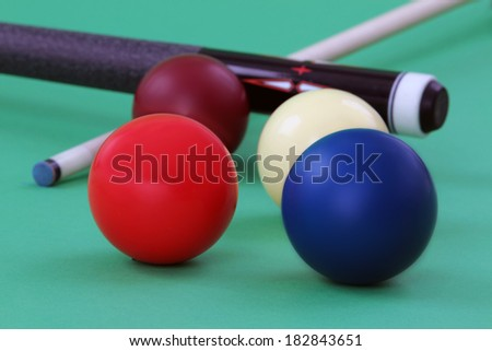 carom balls with billiard cue on pocketless table  - stock photo