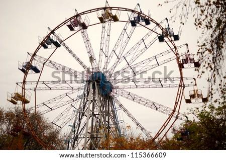 carousel against dull sky - stock photo