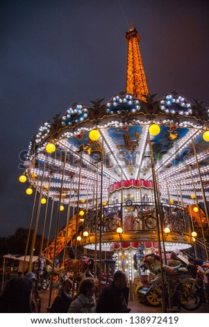 Carousel and the Eiffel Tower - stock photo