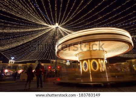 Carousel at night long exposure shot - stock photo