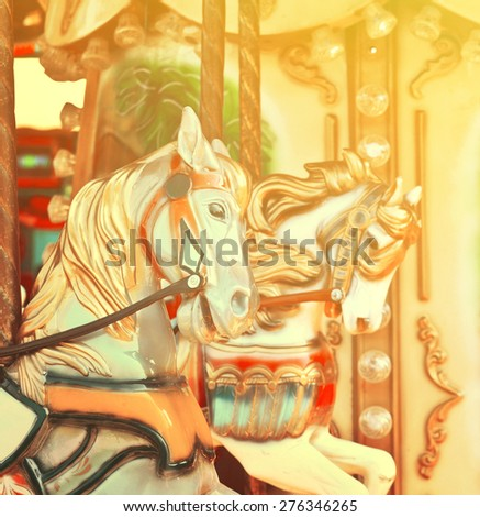 Carousel -  Fair conceptual background with horses in vintage tones - stock photo