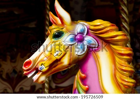 Carousel horse; close-up portrait of traditional fairground carousel  galloping horse  - stock photo