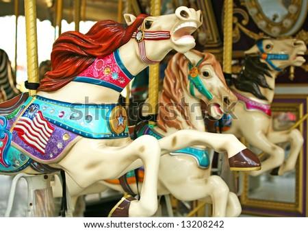 Carousel horse ride - stock photo