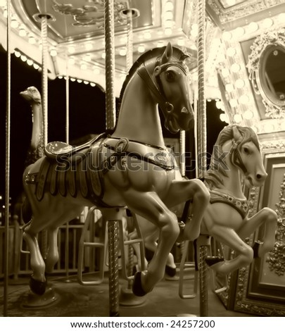 carousel horse ride in black and white - stock photo