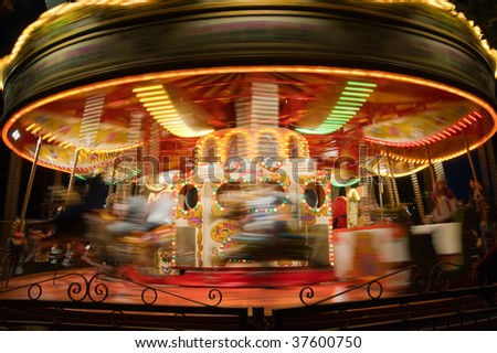 Carousel in motion blur, London park - stock photo