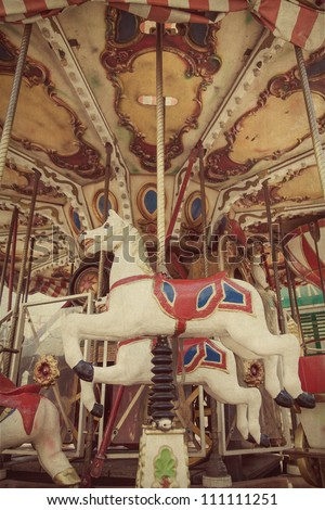 Carousel merry-go-round  at an amusement park - stock photo