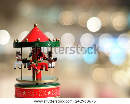 Carousel on neon background  - stock photo