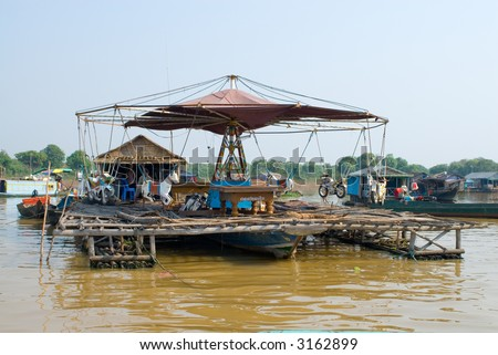 carousel on Tonle Sap lake, Cambodia - stock photo