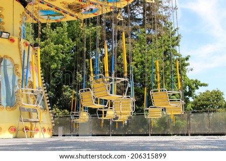 Carousel swing at the fair - stock photo